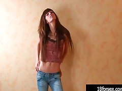 Skinny teen fingers her shaved pussy