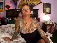 Mature tattooed Slut gets poked