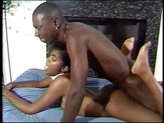 Black guy has threesome with ebonies by fireplace