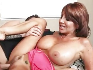 Horny MILF takes a young cock